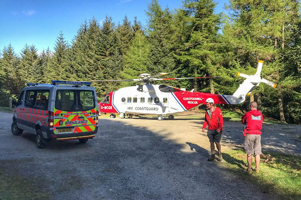 The helicopter at the rescue scene in Whinlatter Forest. Photo: Keswick MRT