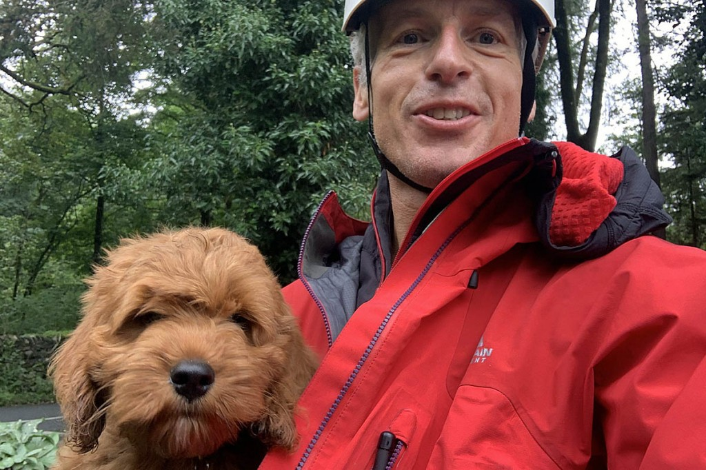 Brody safe with a team member after his adventure. Photo: Keswick MRT