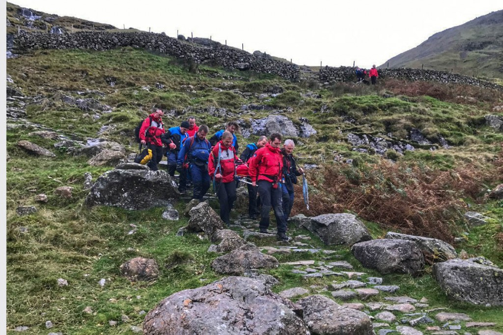 Rescuers stretcher the man down the Sty Head path. Photo: Keswick MRT