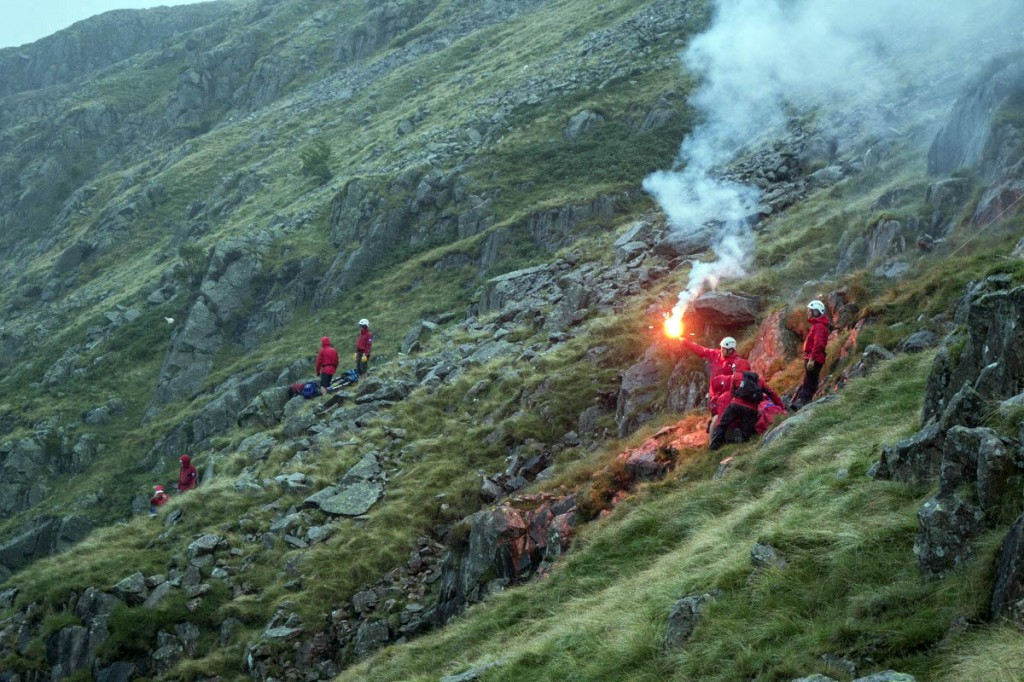 Rescuers at the scene near Hind Crag guide in the Coastguard helicopter. Photo: Keswick MRT