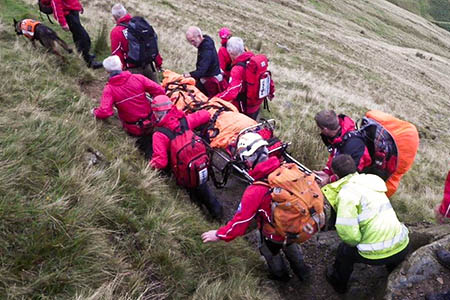 Kirkby Stephen Mountain Rescue Team members stretcher the injured walker from the Cautley Spout site. Photo: Kirkby Stephen MRT