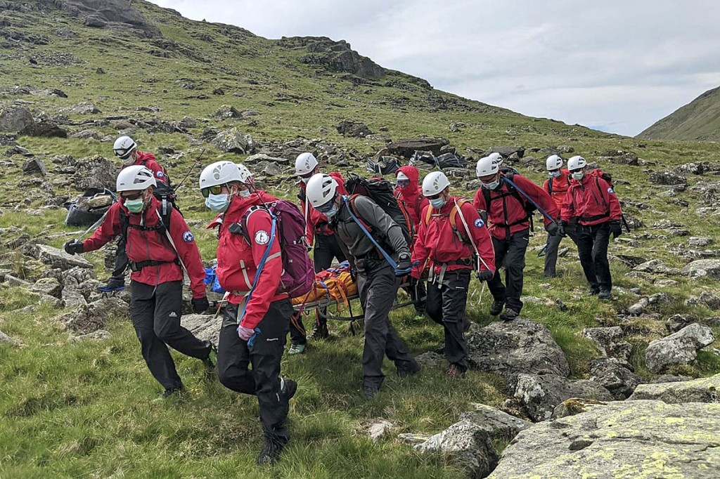 Rescuers have to wear full protective gear during callouts because of the Covid-19 pandemic. Photo: Wasdale MRT