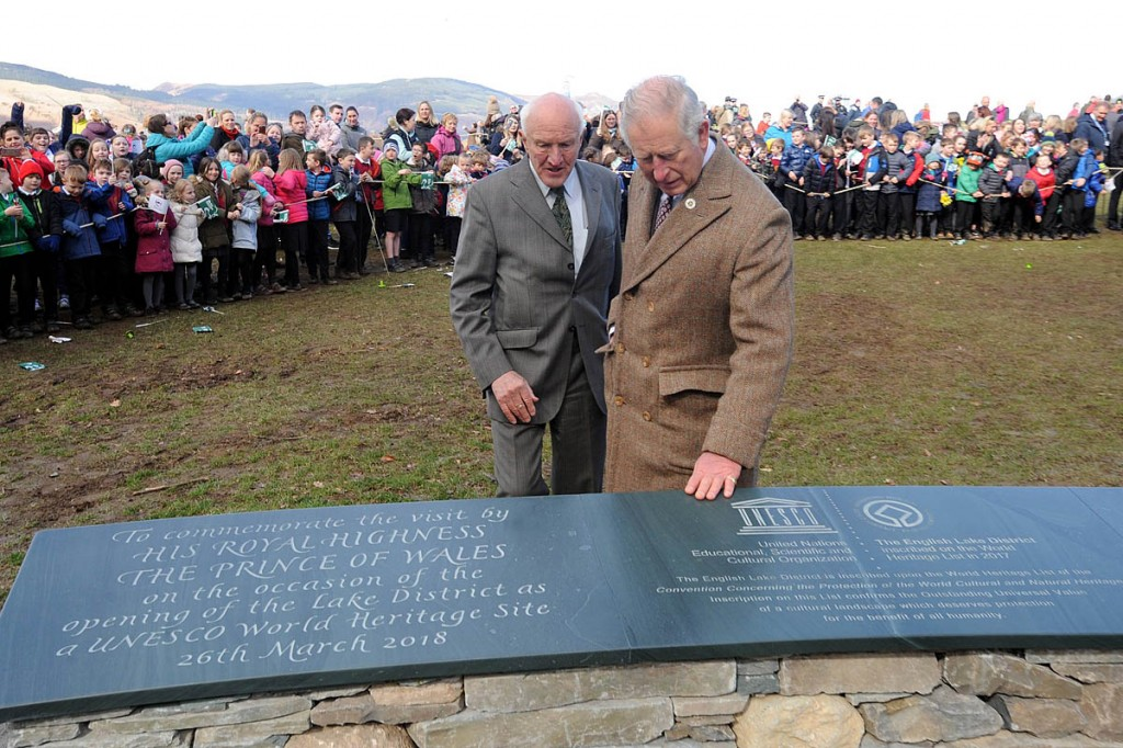 Prince Charles and Lord Clark view the plaque