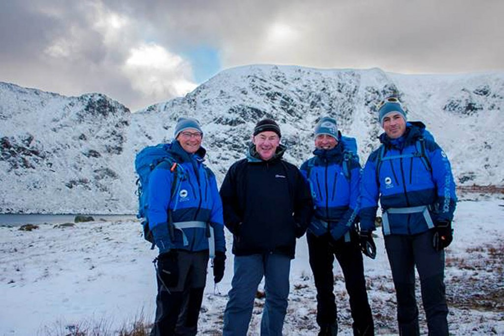 Alistair Boston, second from left, joins this year's felltop assessors at Red Tarn on Helvellyn: from left, Jon Bennett, Graham Uney and Zac Poulton