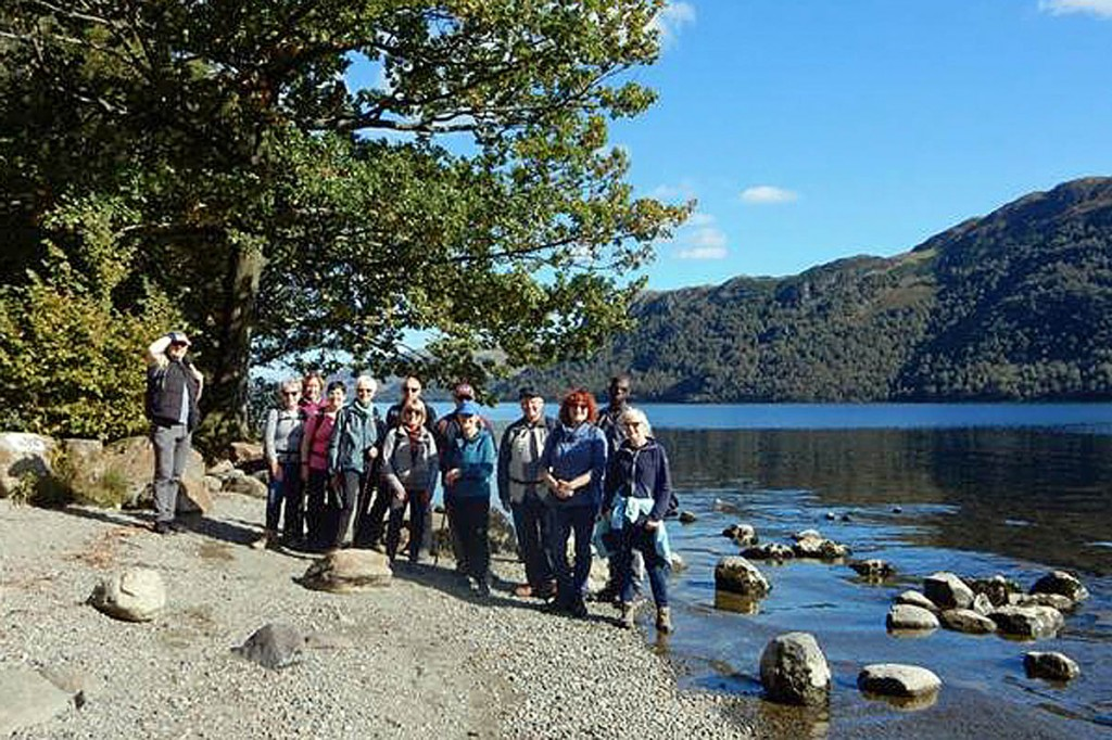 Visitors enjoy an outing alongside Ullswater during a guided walk