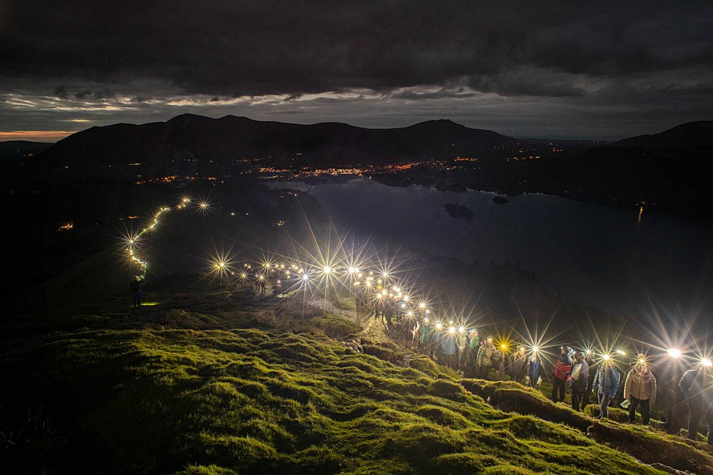 Walkers light up Cat Bells, with Keswick in the distance. Photo: Carmen Norman