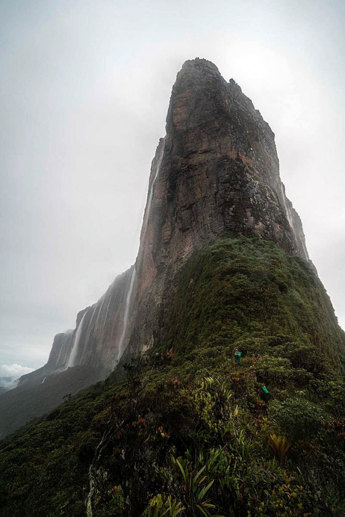 The prow of Roraima, with figures just discernable at its base. Photo: Coldhouse Collective/Berghaus