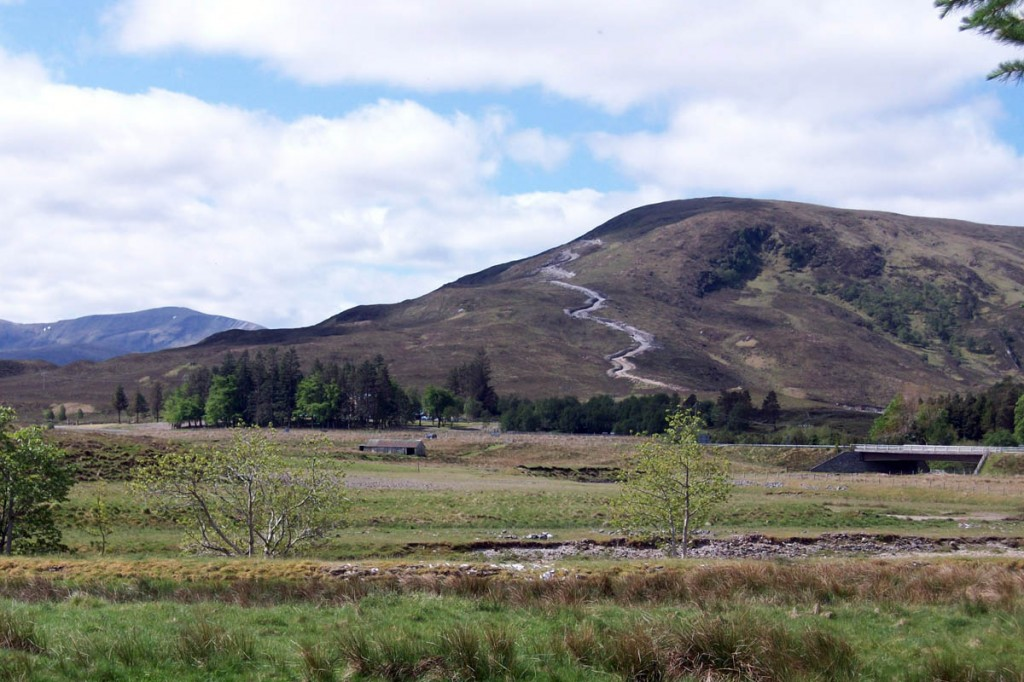 A track scars the flanks of a hill at Ledgowan