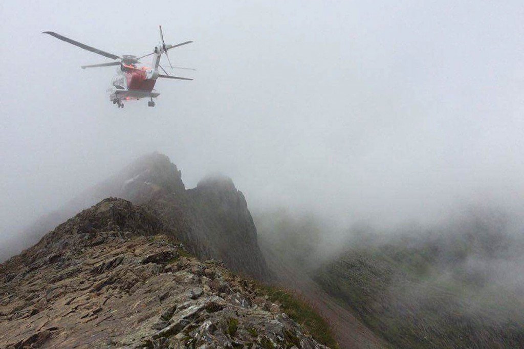 A Coastguard helicopter hovers above Crib Goch during a rescue. Photo: Jamie Rooke