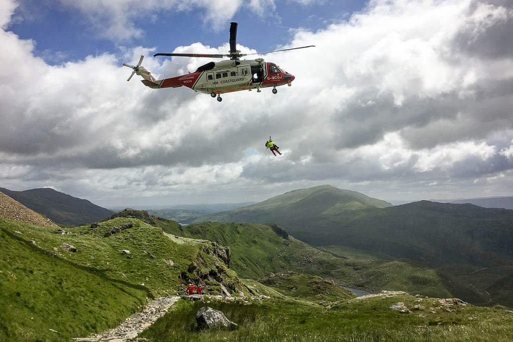 A casualty is winched into a Coastguard helicopter. Photo: Alun Allcock