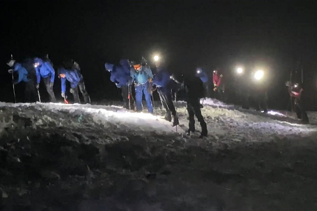 Rescuers search avalanche debris on the mountain. Image: Lochaber MRT