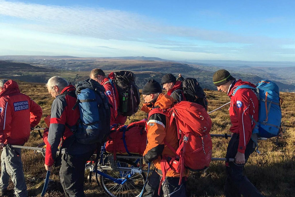 Rescuers stretcher the injured walker from the hill. Photo: Longtown MRT