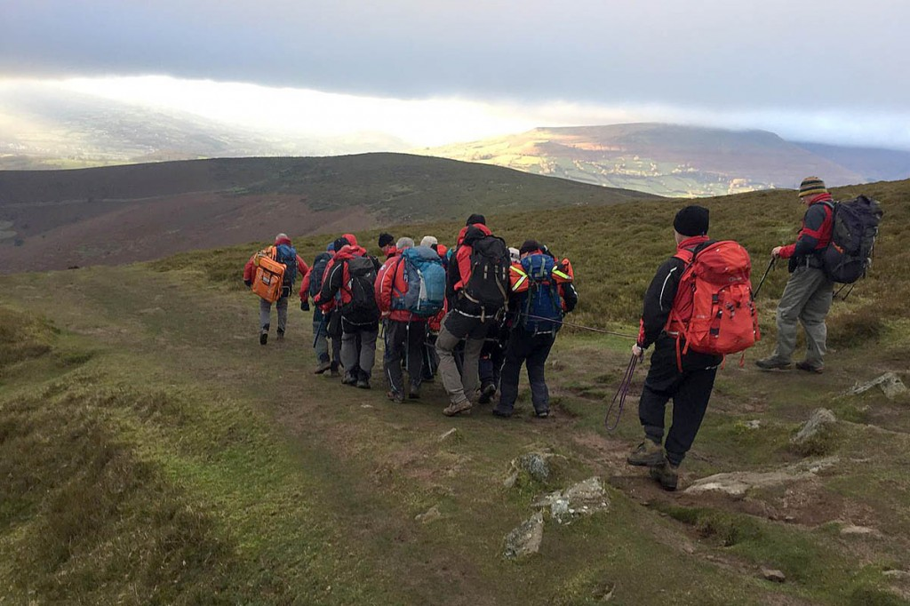 Rescuers stretcher the injured walker from Sugar Loaf. Photo: Longtown MRT
