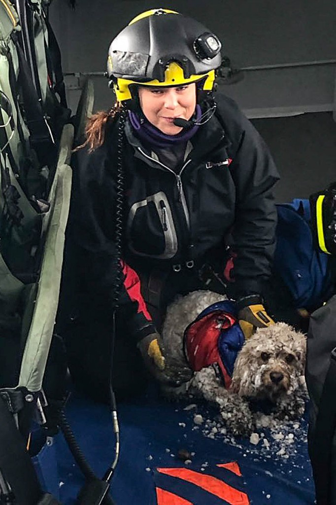 Ben safe onboard the Coastguard helicopter with winchman Kate Willoughby. Photo: MCA