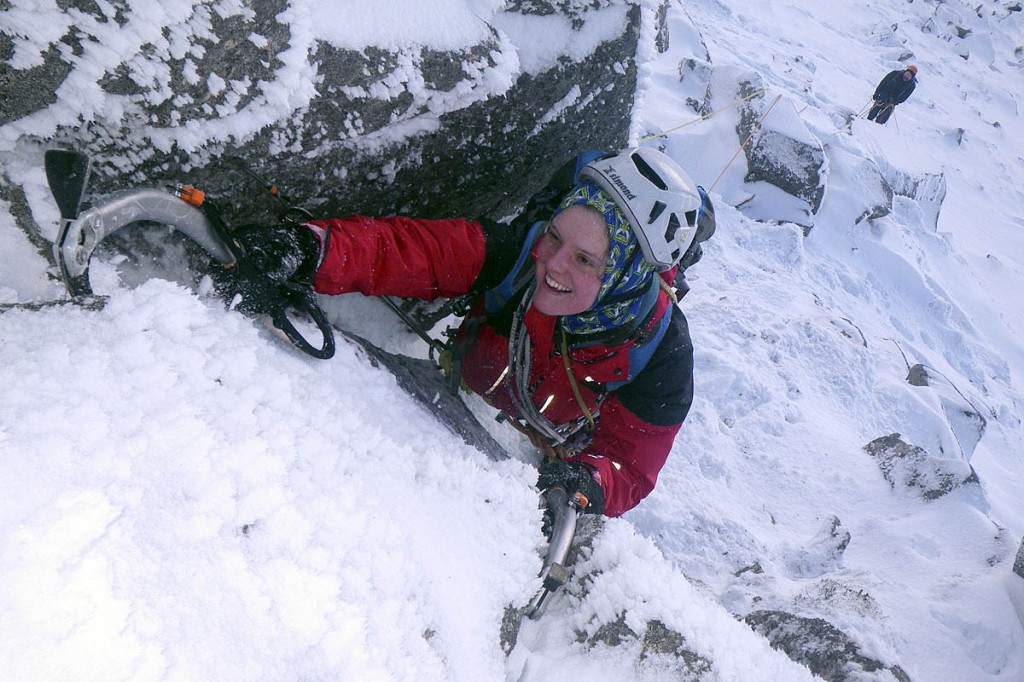 A student leads her first winter climb
