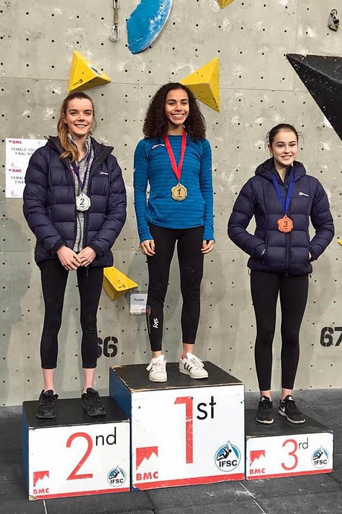 Molly Thompson-Smith, centre, takes to the winner's podium