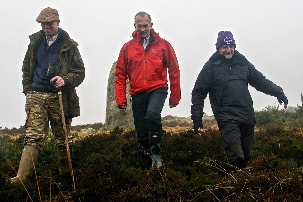 Perthshire gamekeeper Josh Burton, left, is joined by Mountaineering Scotland president Mike Watson and Mountaineering Scotland volunteer Dave Gordon, right.