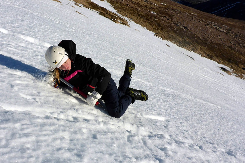 A student practises ice-axe braking