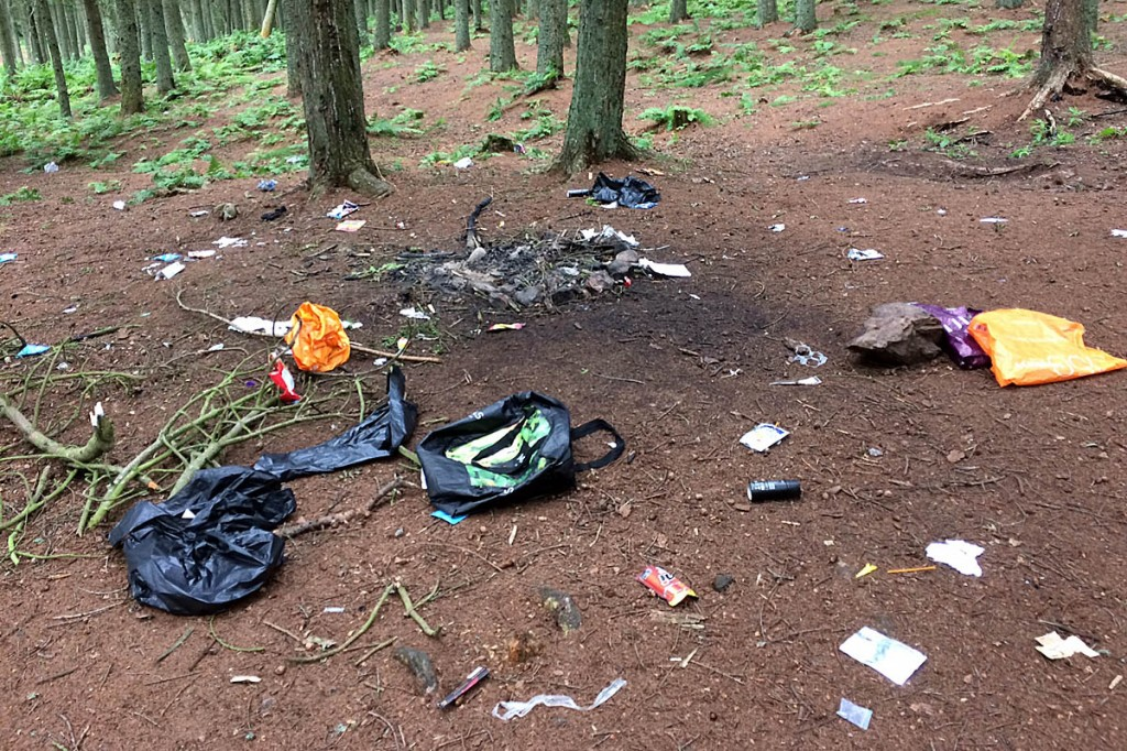 Rubbish and fire damage at an abandoned campsite near Bonaly Reservoir in the Pentlands. Photo: Pentlands Regional Park