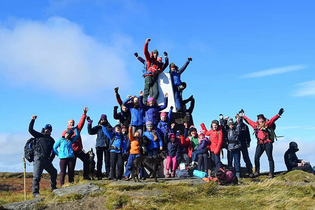 The sponsored walkers celebrate at the summit of The Cheviot