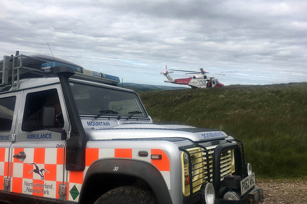 The Coastguard helicopter with one of the rescue team's vehicles. Photo: Northumberland National Park MRT