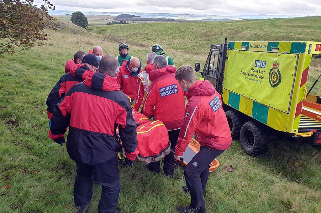Rescuers stretcher the injured walker to the ambulance service's all-terrain vehicle. Photo: NNPMRT