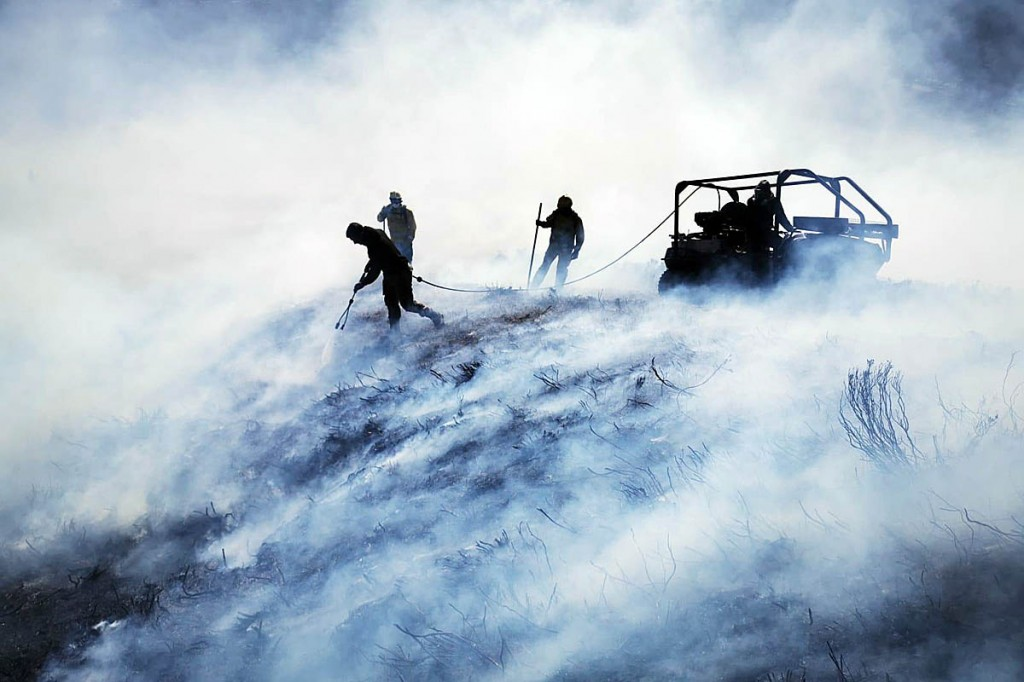 Firefighters in action during the blaze on Simonside. Photo: NNPMRT