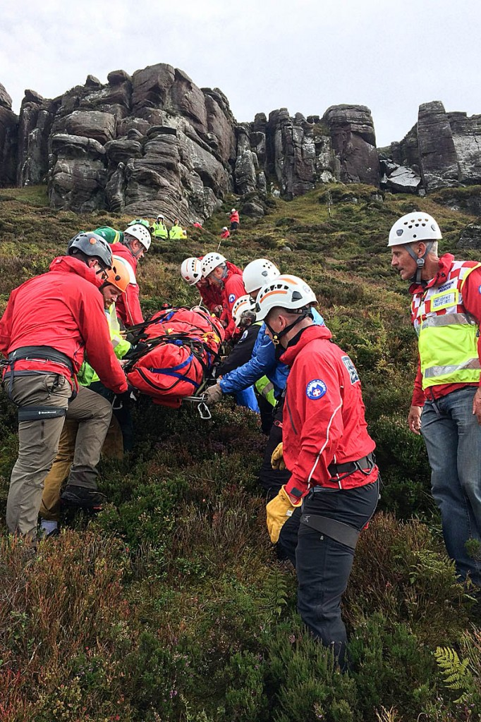 The injured climber is stretchered from the crag. Photo: NNPMRT