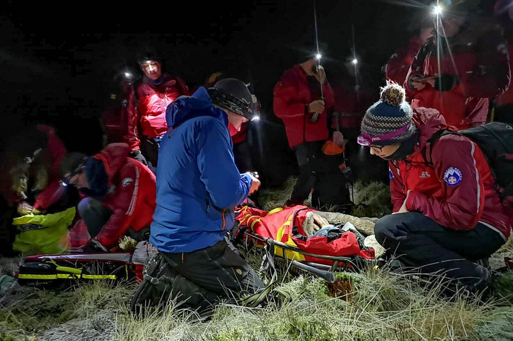 Rescuers with the collapsed runner. Photo: Northumberland NP MRT