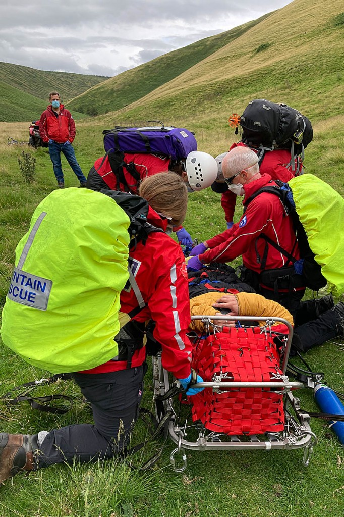 Rescuers tend to the mountain biker at Usway Burn. Photo: NNPMRT
