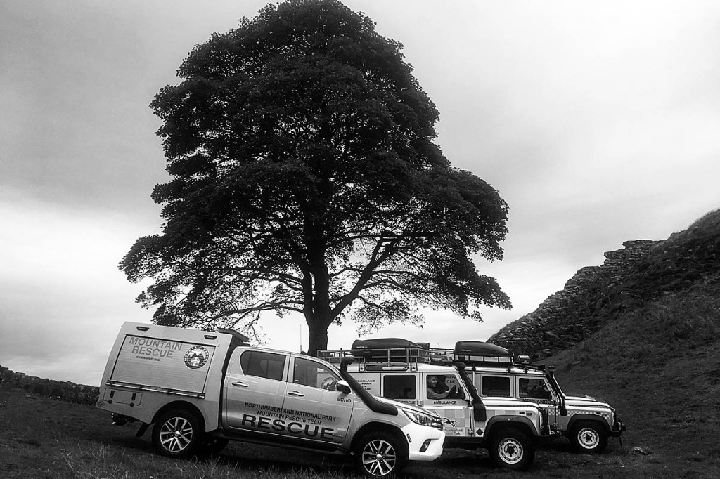 Team vehicles at Sycamore Gap on Hadrian's Wall. Photo: NNPMRT