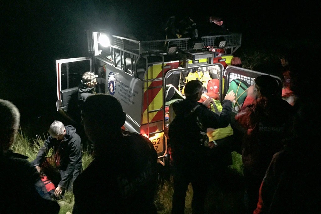Rescuers load the injured walker into the Land Rover. Photo: Northumberland NPMRT