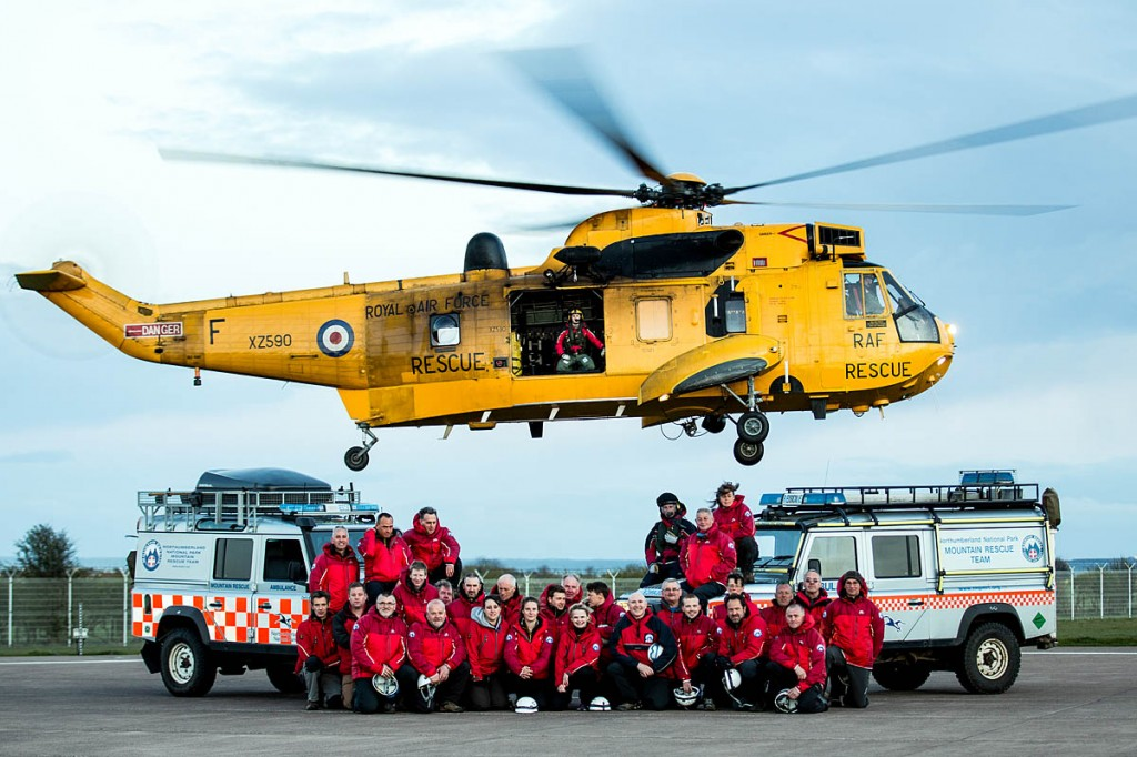 The Northumberland National Park Mountain Rescue Team with an RAF Sea King helicopter before the service ended