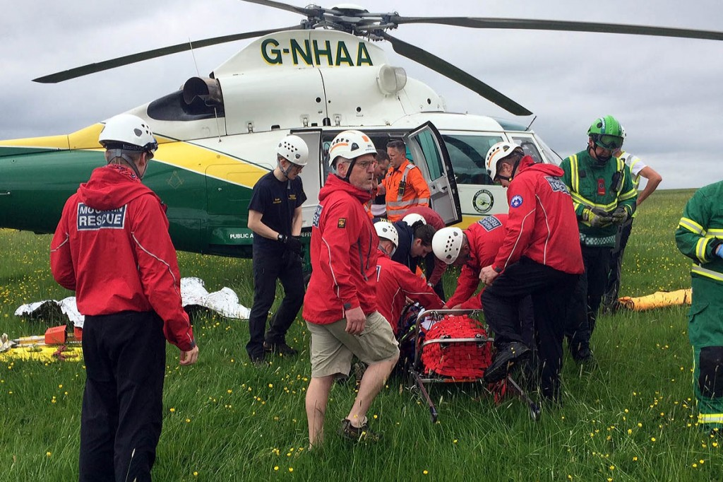 The injured woman was stretchered to the Great North Air Ambulance. Photo: Northumberland National Park MRT