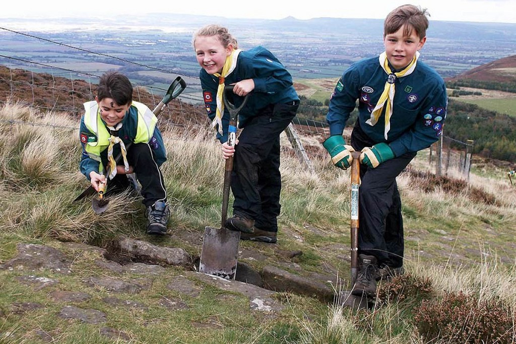 Scouts from the 1st Marston Moor group clear drainage channels on the Cleveland Way. Photo: Tammy Andrews
