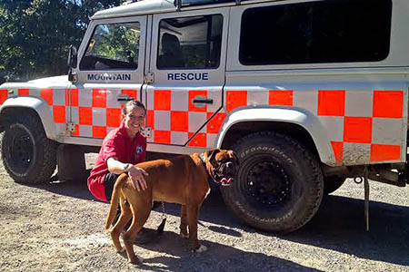 Newsar team member Carly Smith with the canine casualty. Photo: Newsar