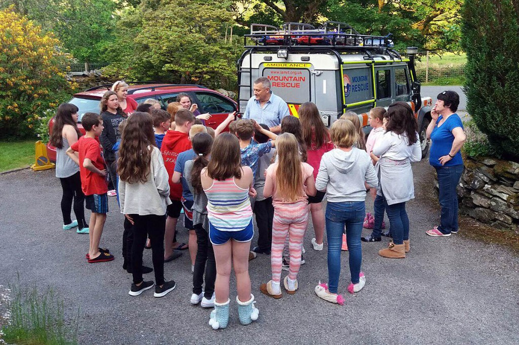 Nick Owen shows the young people of St Mary's School, Davyhulme how mountain rescue works. They donated more than £100 in return