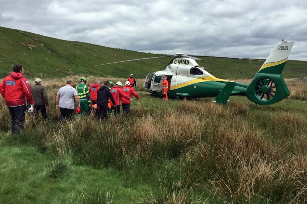 Rescuers stretcher the injured Peel Crag climber to the air ambulance. Photo: Northumberland NPMRT