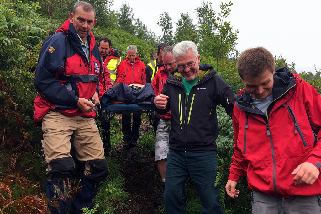 Rescuers stretcher the injured walker down the steep slope: Photo: Northumberland NPMRT