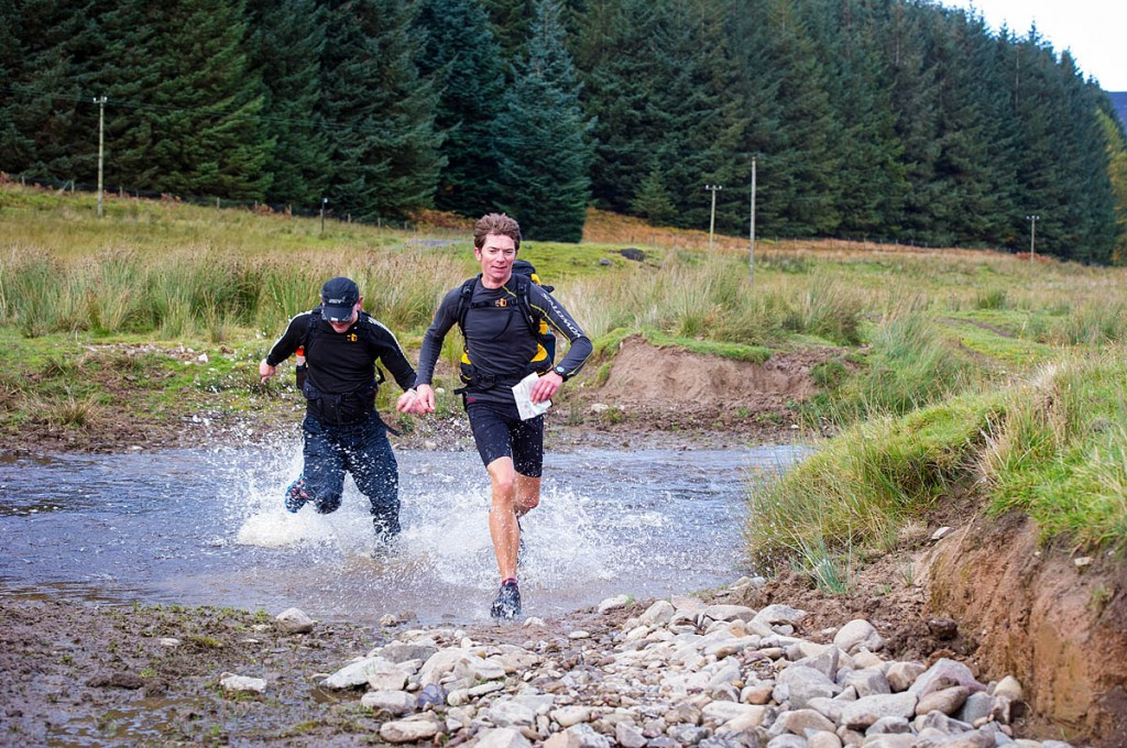 Competitors get their feet wet during the OMM. Photo: Victoria Middleton
