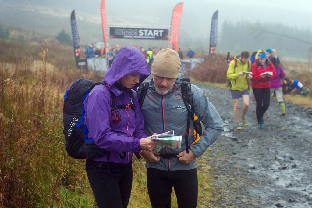 Team members plan their route at the run's start. Photo: OMM
