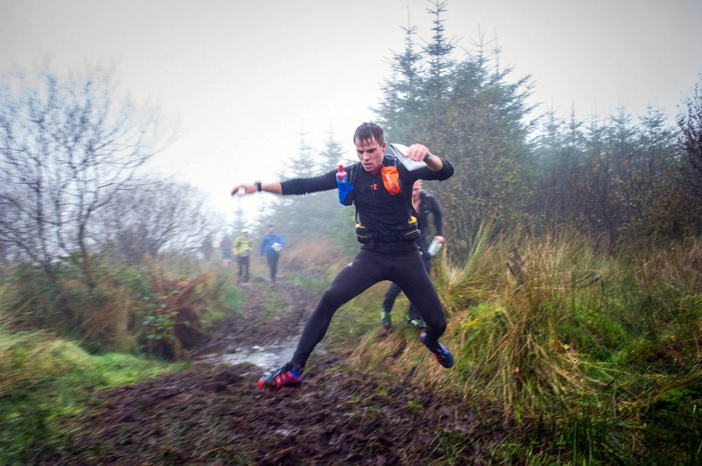 A competitor leaps across one of the event's bogs. Photo: OMM