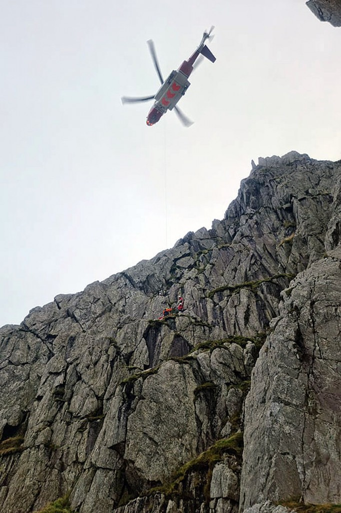 The Coastguard helicopter in action above South Gully on Tryfan. Photo: Dave Brown/OVMRO