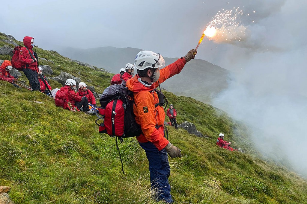 Team members guided the helicopter in using a flare. Photo: OVMRO