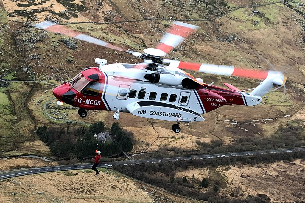 A rescue team member is winched at the site. Photo: Ogwen Valley MRO