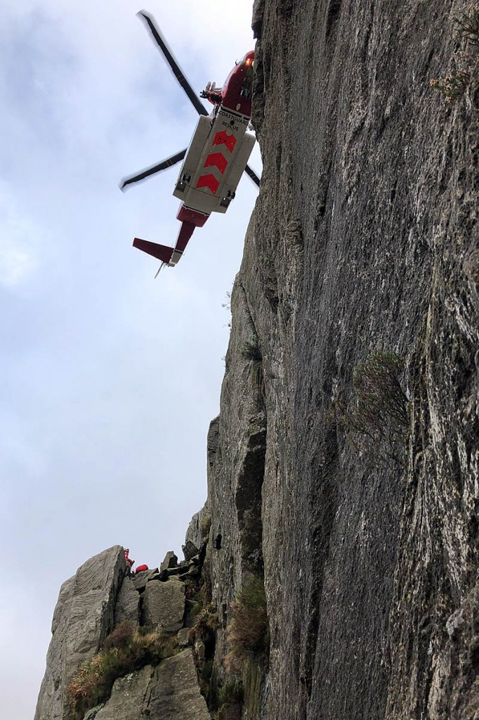 The Coastguard helicopter at the rescue scene. Photo: Ogwen Valley MRO