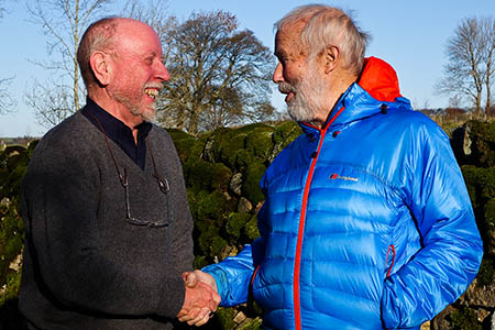 Roly Smith, left, hands over to Sir Chris Bonington. Photo: Jonathan Williams