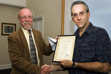 OWPG president Roly Smith presents outdoor feature award to Jon Sparks. Photo: Rudolf Abraham