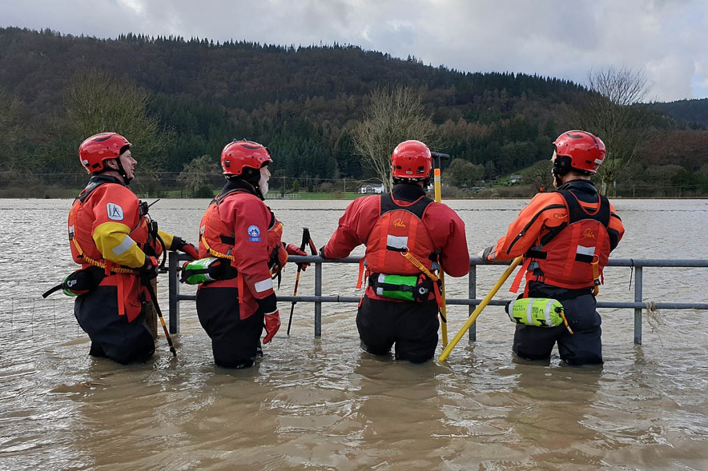 Swiftwater rescuers from Ogwen Valley MRO survey the scene in Llanrwst. Photo: Ogwen Valley MRO