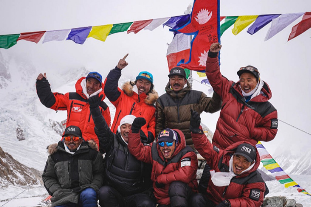 The Sherpa group on the summit of K2. Photo: Nimsdai Purja